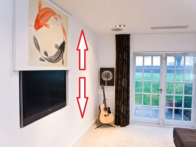 """Vertical Picture Lift from Future Automation designed to hide flat screen TV's. Artwork on a motorised lift is raised and lowered to reveal a wall mounted recessed TV Screen. Available in 3 different models accomodating screen sizes from 32"""" to 50"""". AV Installs provides a full range of moving artwork lifts along with installation services."""