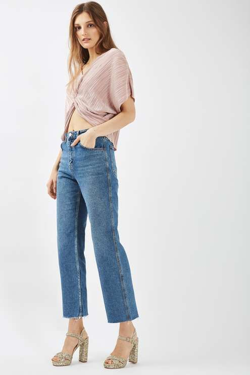 Bridge the day to evening transition with the batwing sleeved, twist front top in this of-the-moment nude plisse. We love it styled with a high-waisted trousers for a chic finish. #Topshop