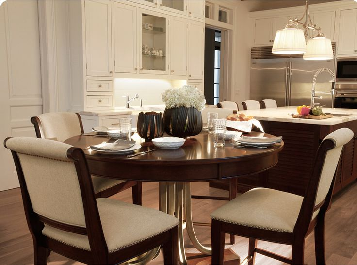 Up the style factor in your eat-in kitchen with a round wood pedestal table and upholstered dining chairs.
