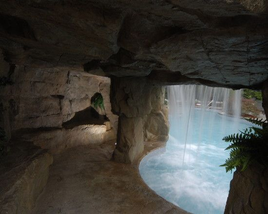 cave grotto enclosed slide with waterfalls tropical pool new york aquafx