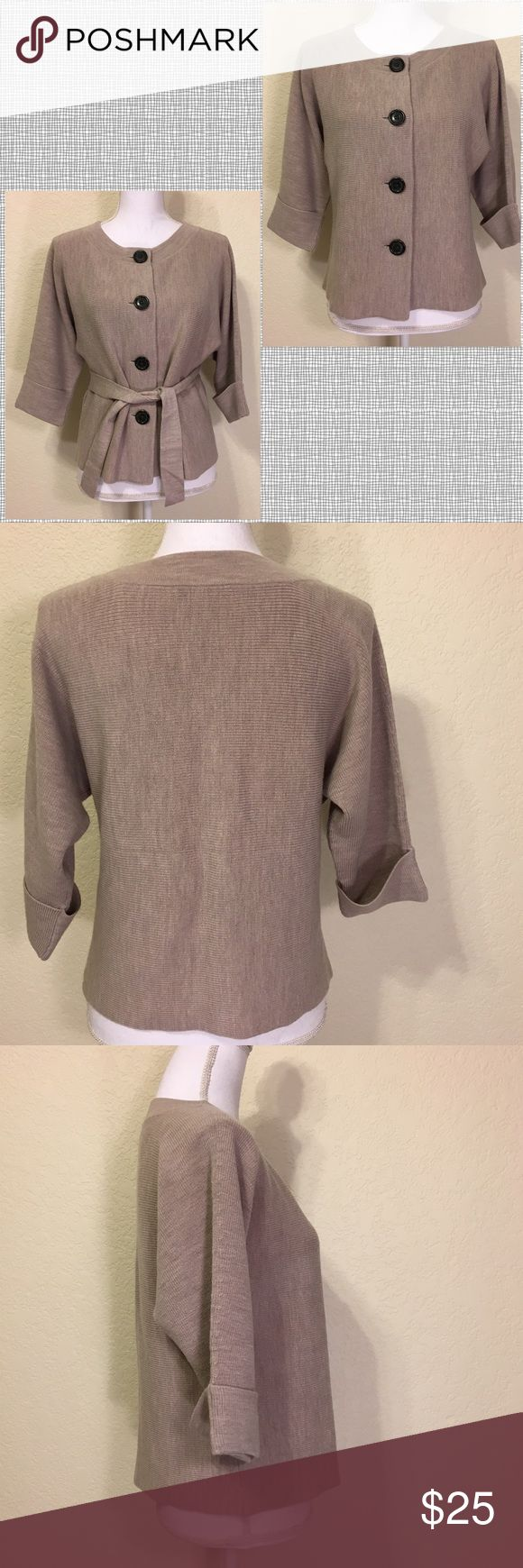 """NWOT Banana Republic Taupe ¾ Sleeve Wool Sweater NWOT Banana Republic Taupe ¾ Sleeve Wool Sweater.  Size M Petite.  Comes with tie.  Four tortoise shell buttons front.  Cuffed ¾ sleeves.  Length shoulder to hem: 21"""".  Bust: 38"""".  Bottom of sweater: 40"""" around.  Sleeve length: 15"""".  Cuff width: 5"""".   100% wool.  Hand wash cold or dry clean. Banana Republic Sweaters Cardigans"""