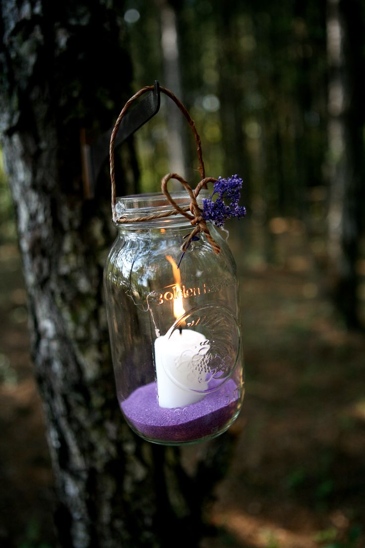 Mason Jars with Citronella votive candles..Perfect for an outdoor wedding. love the colored sand. I've been personally collecting glass jars (from pasta sauce/candles...) for ideas like this for my future Wedding :) -RP                                                                                                                                                      More