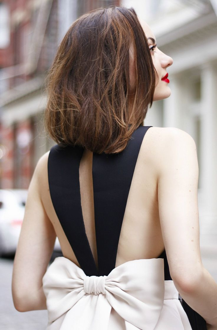 Structured elegance & red lip.