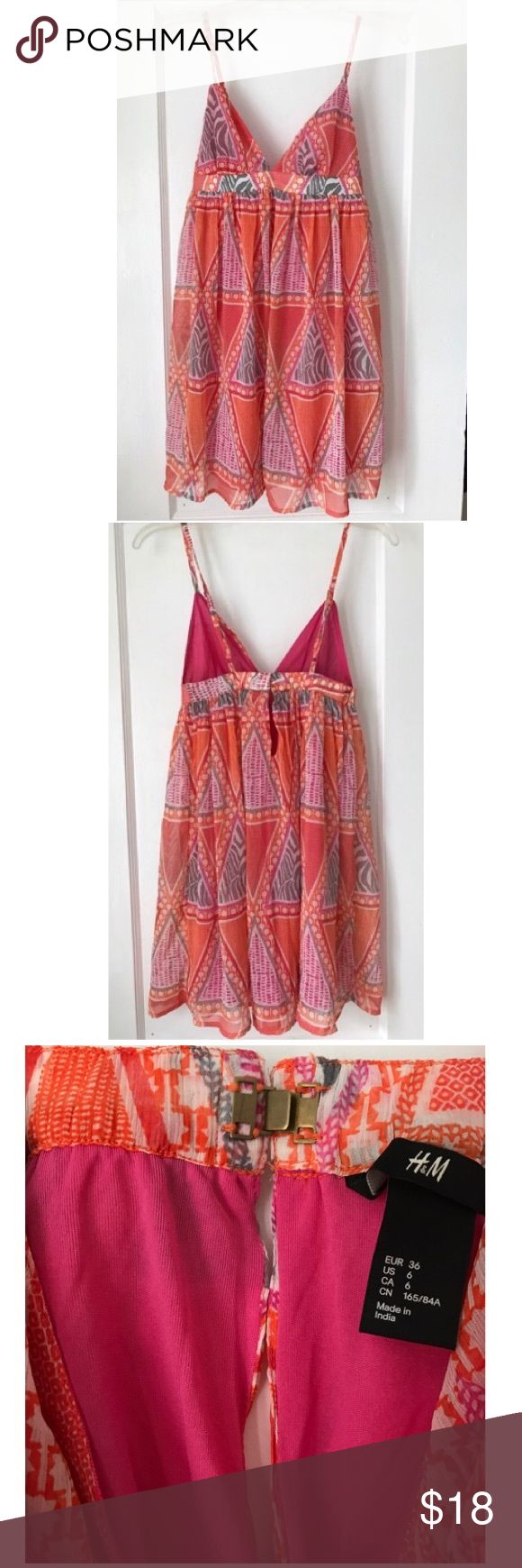 Vacation Dress Pink and orange H&M spaghetti strap dress- perfect to wear on any tropical vacation! Dress has adjustable straps, and hook and closure with short slit in the back (see photo 3.) NWOT because there's not a lot of boob coverage (covers about what a triangle bathing suit top does.) H&M Dresses Backless