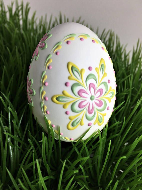 This is a very small duck egg (medium chicken size egg) in its natural white color. It is decorated in soft green, yellow, and pink wax. To create this egg, I used the pinhead method also known as the drop-and-pull pinhead method. In this method of making pysanky, mostly used in Poland, the Czech Republic, Slovenia, and Lithuania, a pin stylus is used as a tool. The head of the pin is dipped into hot wax and applied to the eggshell. There are two basic techniques used in this method…