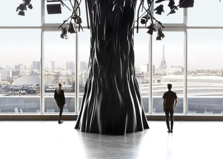 Lighting projectors and cables hang from the spindly branches of chunky black trees inside this penthouse bar and nightclub in Paris.