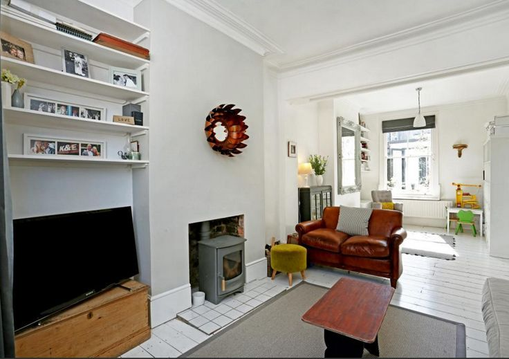 White floorboards charnwood woodburner stove knocked for Through lounge design ideas
