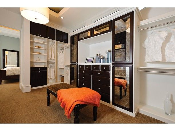 The master suite's closet feels like a lounge in plan DHSW75737. On one side, you've got the spacious master bedroom. On the other, the stunning master bathroom beckons you to relax in the huge shower or tub.