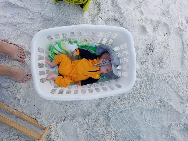 taking baby to the beach is a breeze using a laundry basket! baby's first beach trip!