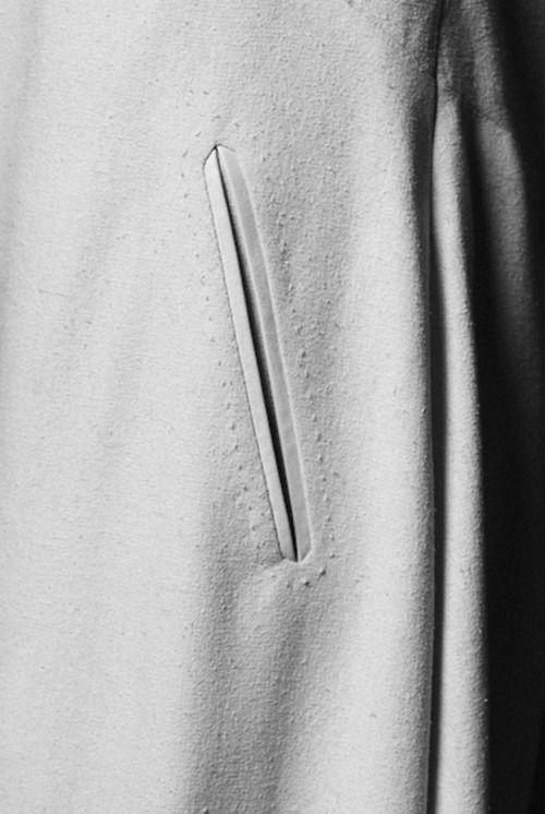 Slanted welt pocket with subtle stitch detail - fashion design; sewing techniques