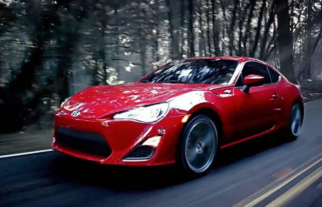 2013 Scion FR-S in red, front three-quarter dynamic screencap from first ad. I want this