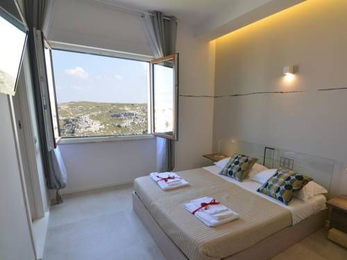 Punto di Vista Matera Punto di Vista offers elegant-style accommodation, just a 5-minute walk from the centre of Matera. Free WiFi is available throughout.  All air-conditioned rooms come with a HD flat-screen TV and a small fridge.