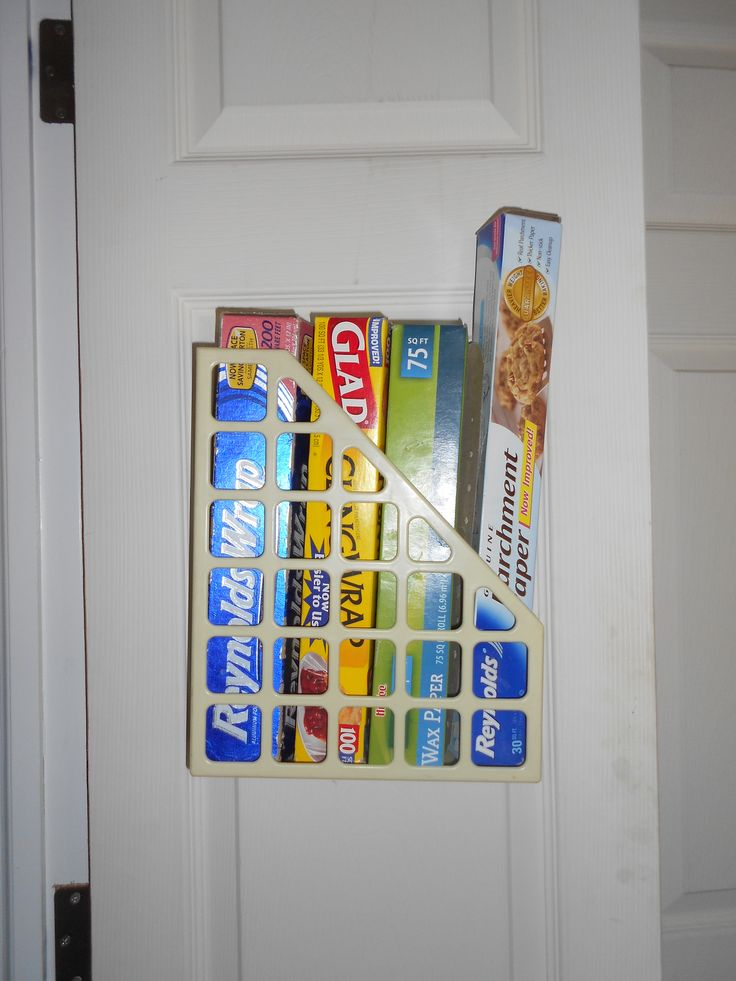 Storage on the inside of pantry door. Had a couple of magazine boxes hanging around collecting dust. Just put a few screws to hold it on the inside of the pantry door. Have 2, one for the wax paper/saran wrap and the other for plastic baggies, of which I snipped a few of the cross pieces so I can just pull the baggies out instead of pulling the whole box out.