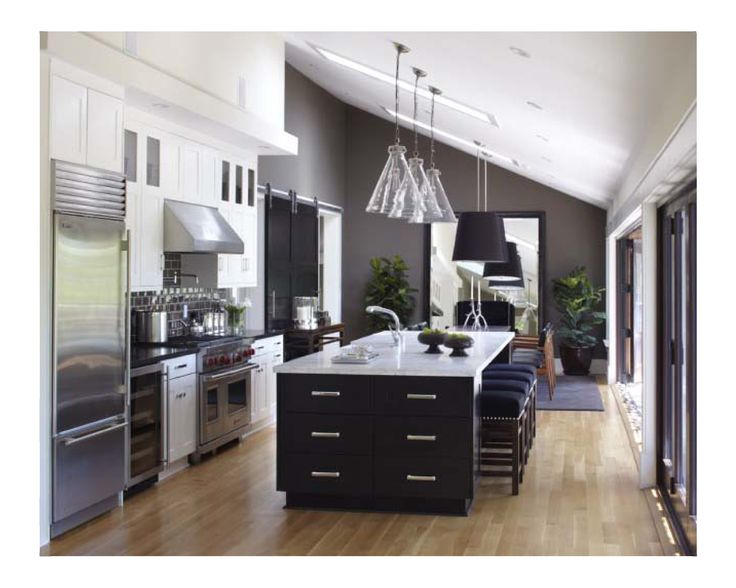 with lighting over cabinets to deal with upward sloping ceiling