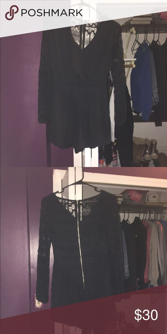 Black dressy romper From Charlotte Russe only worn once for a few hours. Doesn't fit me anymore, it's Lacey in the back so it's see through see second picture Charlotte Russe Dresses Mini