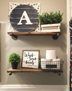 Bathroom decor, farmhouse bathroom decor, farmhouse decor, farmhouse style, modern farmhouse, greenery, faux greenery, diy shelves, plumbing shelves, bathroom shelves, farmhouse bathroom, shelf decor, bathroom shelf decor, See Instagram photos and videos from Robin Norton (@rock.n.robs)