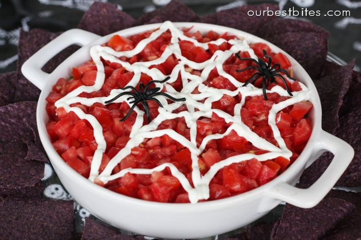 Spider Web Dip - do a basic 7-Layer taco dip. Put some sour cream in a plastic baggie with the end snipped off and use it to draw a web pattern. Throw on a fake spider or two and your favorite party dip is instantly creepy!