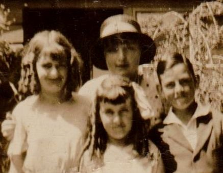 L to Right back row; Marge, Gwen. Front row; Peggie & Eric Williams in their front garden at Cremorne. Must be fans of Shirley Temple or learning Scottish dancing