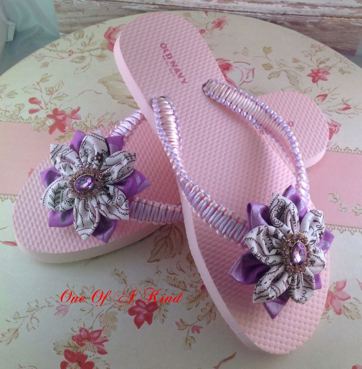 Pink and Lavender Flip Flop in macrame with a Kanzashi Flower. $30.00 plus shipping Size 7 https://www.facebook.com/pages/One-Of-A-Kind-Accessories/850007711724774