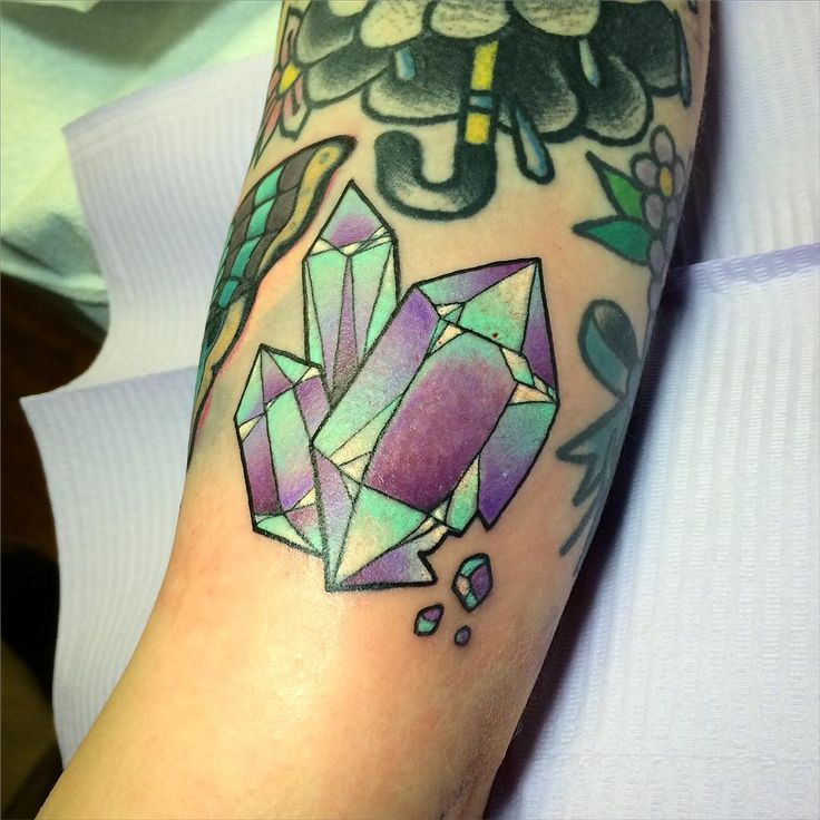 """Crystals from my sketch book to cover some ink bleeding from another tattoo not done by me.  #hfxtattoo #helenadarling @hfxtattoocompany"""