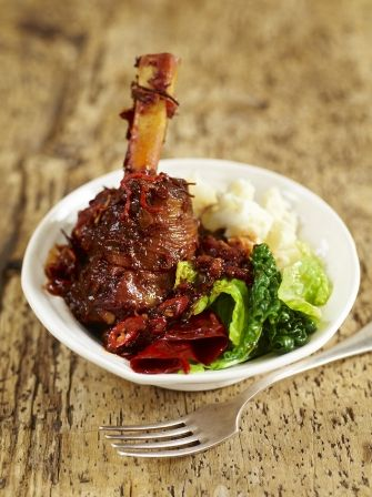 Jamie Oliver's beautiful lamb shanks recipe makes for a killer dinner; red chillies are rehydrated in apple juice with raisins creating a sticky sweetness.
