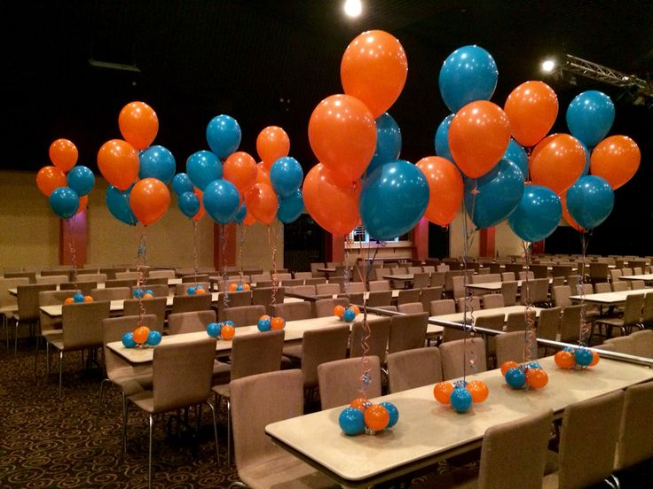 Tropical Teal And Orange Table Centres For Worlds Greatest Shave Event Mounties Helium Table