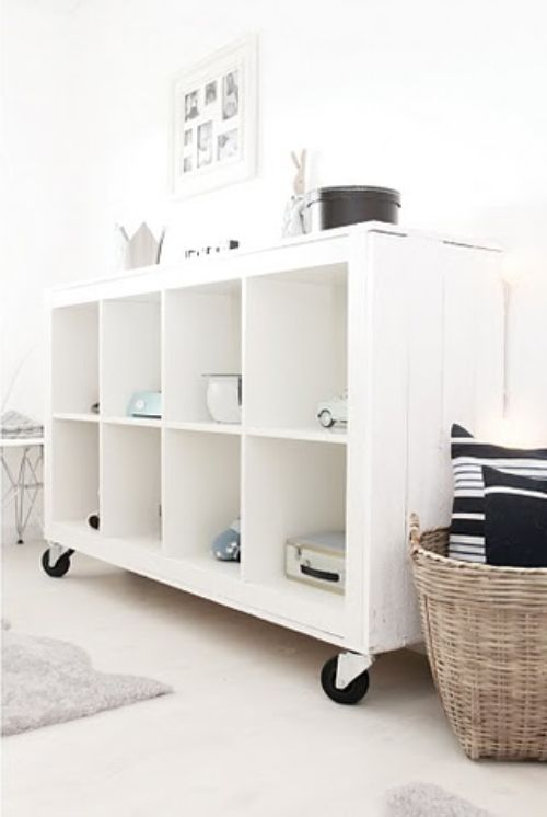 Ikea Expedit bookcase and simply covered the sides and top with rough planks, and added casters, before painting the whole thing white. Stylist's Life: Kjerstis Lykke