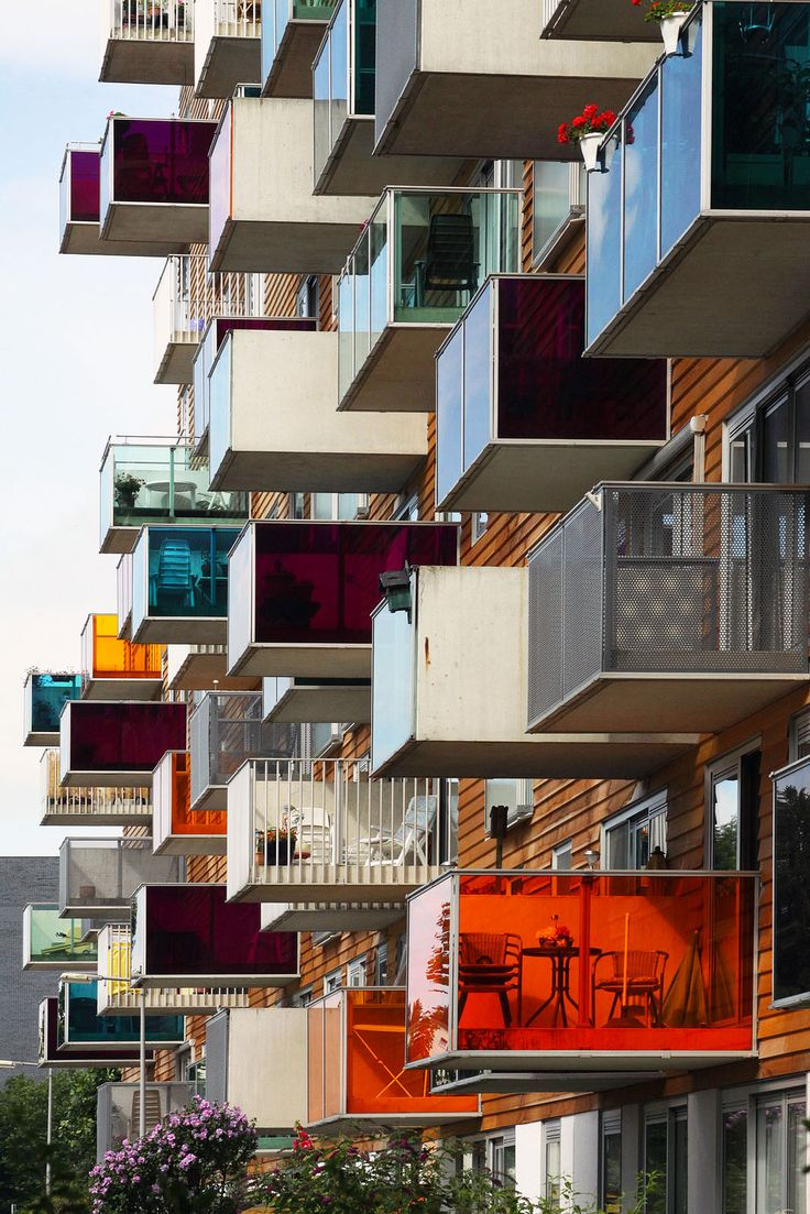 Colorful balconies, creative #Architecture. Commissioned by the Het Oosten Housing Association, Wozoco - built between 1994-1997 is a building of 100 homes located in Ookmeerweg street, Amsterdam-Osdorp, Netherlands.