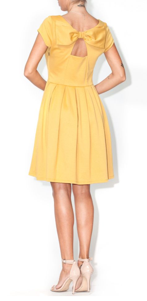 Mustard bow back pleated dress perfect for fall. Available at Block Party Handmade Boutique or order online at block-party-handmade-boutique.shoptiques.com