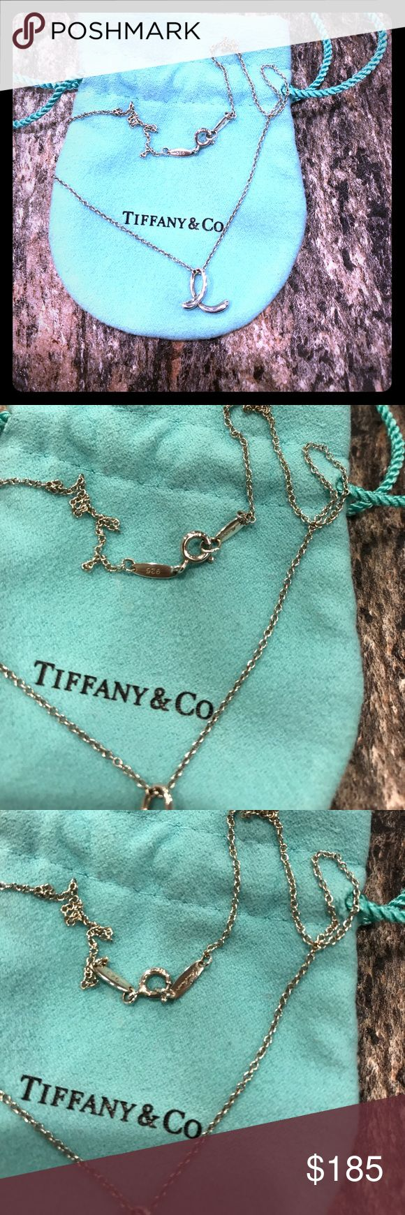 "🎈SALE🎈Tiffany and Co ""E"" Initial Necklace Authentic Tiffany & Co lower case Elsa Peretti design ""e"" initial necklace. Sterling silver with all hallmarks as shown above, including 925, Tiffany & Co and Elsa Peretti. This necklace is in excellent condition, worn only a couple times. Still sold by Tiffany & Co in stores and online! Comes with original dust bag. Tiffany & Co. Jewelry Necklaces"