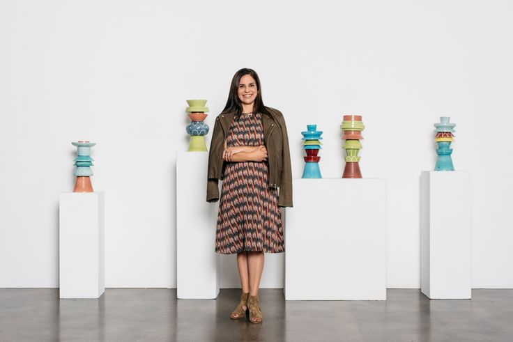 Standing in front of Edgar Orlaineta, Modular Katsinas #1-15, ceramic, in four parts, Miki Garcia wears a Harold multi jewel color dress by Isabel Marant/Etoile, Han leather moto jacket by Iro and Matteo, and mineral suede block heels by Rag & Bone (all from DIANI, 1324 State St., 805/966-3114, dianiboutique.com). All jewelry is from Garcia's personal collection. Makeup by Tomiko Taft and hair by Taryn Bazzell of TropiCali Beach Beauty Boutique. Photo by Cara Robbins.