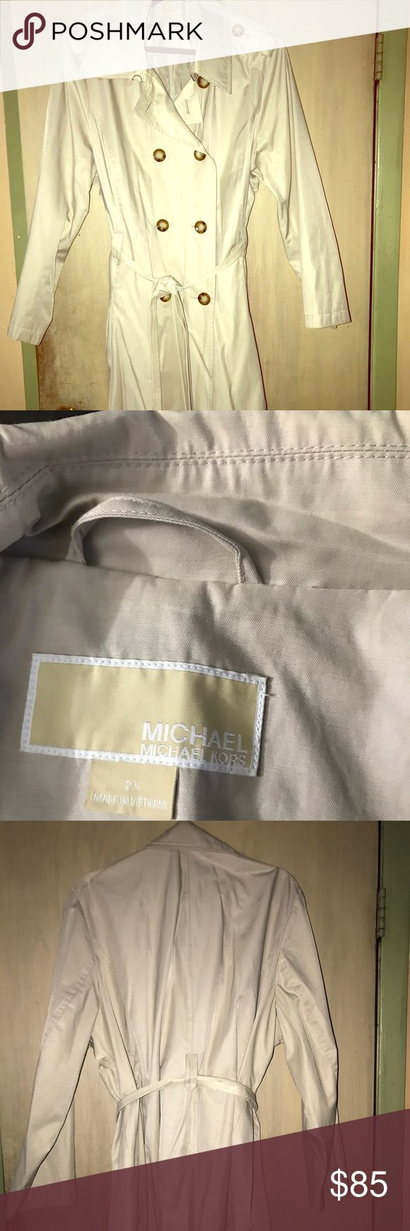Michael Kors spring trench coat / rain coat Barely worn size 2x Michael Kors women's rain coat / trench coat. Great fit with belt. Looks amazing dressed up or casual. Small lipstick stain on left sleeve by wrist visible in pictures only flaw. Thanks for shopping my closet Michael Kors Jackets & Coats Trench Coats
