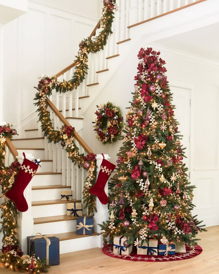 Rich colors and exquisite embellishments give our Christmas foliage a luxurious look that's fit for royalty. This exclusive collection features red magnolia blooms with alternating velvet and glittered petals, complemented by green pine needles and crimson berry accents.