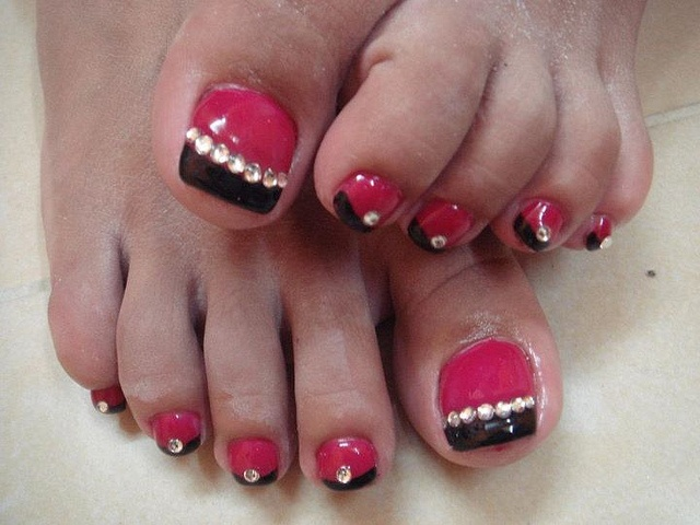 pink and black with stones nails