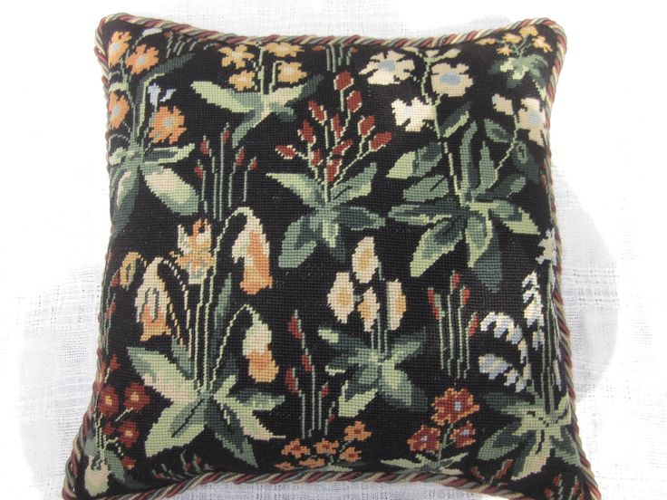 Arts and Crafts design cushion worked by hand in wools in tent-stitch.