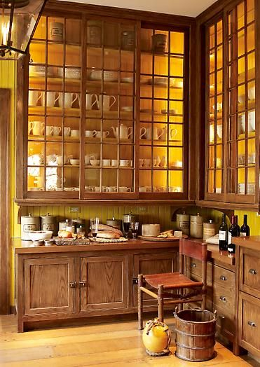 This is stunning.  Maybe because I dream of having this much storage in my kitchen.  Maybe because the yellow walls are rich and warm.  Either way, I love it!