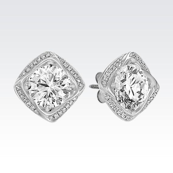 Add pizzazz to your solitaire earrings with these square shaped earring jackets.  Fifty-six round diamonds, at approximately .15 carat total weight, are set in quality 14 karat white gold. Simply put the post of your solitaire earrings through the center of the earring jackets to create a bold new look.  These jackets fit up to and look best with a 1.00 carat stone or a 6.5mm pearl in each ear.  The diamond solitaire earrings pictured are not included.