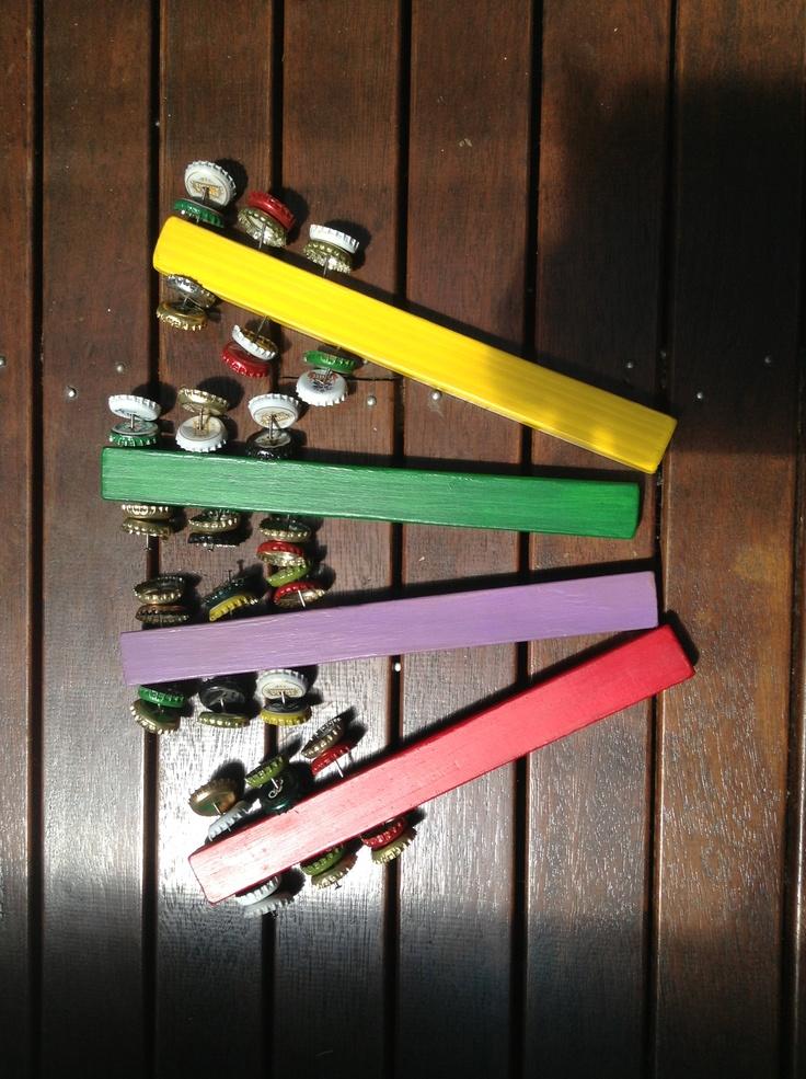 DIY largerphones. Pine, paint, nails and bottle caps. So jingly!