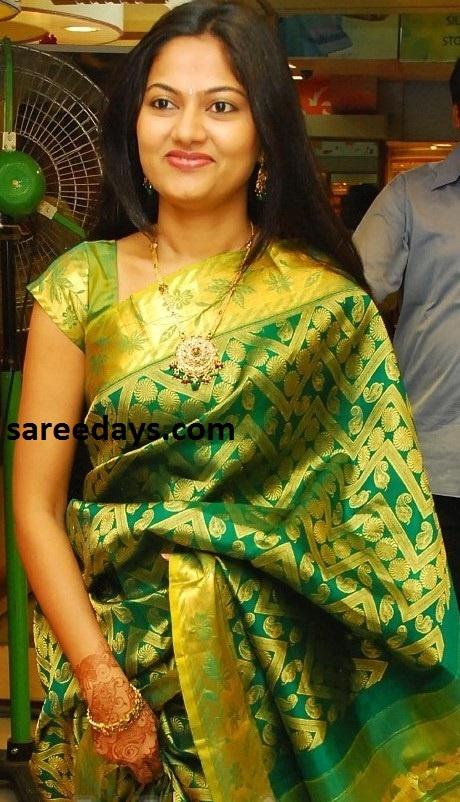 Gorgeous green pattu bridal saree.