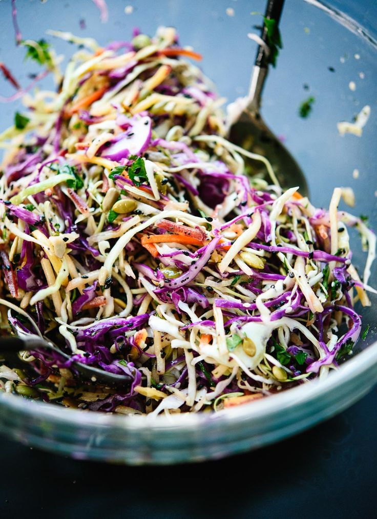 This healthy slaw recipe tastes amazing! It's made with a simple lemon dressing and features toasted sunflower and pumpkin seeds. Gluten free and vegan.