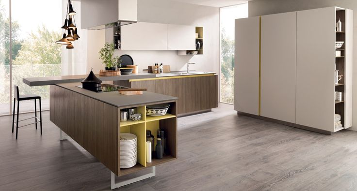 FiloLain33 - A dynamic personality with an eco-friendly flavour for a kitchen where all the quality and aesthetics of a high end project are affordable. The warmth of the thermostructured elm cortex NT with ecolaccato colours makes a big impact.