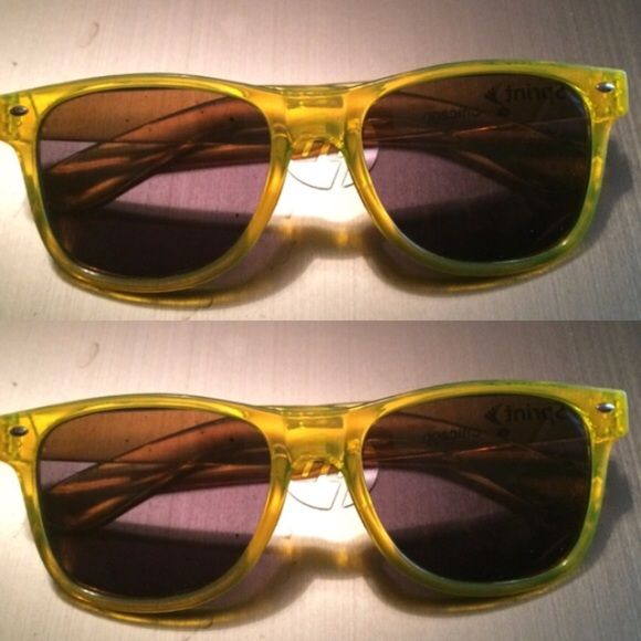 """2 pairs of Neon yellow sunglasses 2 pairs of neon yellow sunglasses. Says """"Sprint for Chicago"""" on the left side. Super good tint. Accessories Glasses"""
