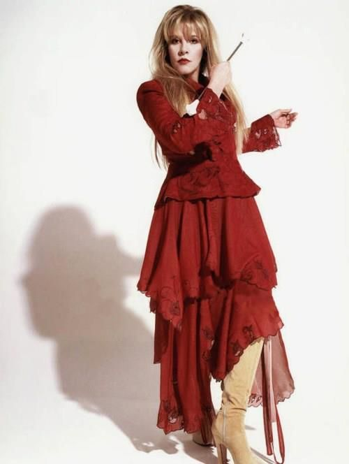 Beautiful red dress and trademark platform boots. Stevie Nicks circa 1997 during their comeback The Dance tour.