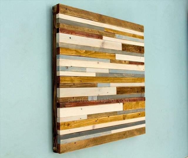 http://palletfurnitureplans.com/pallet-furniture/wooden-pallet-sculpture-wall-art/
