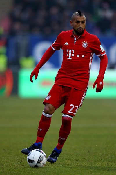 Arturo Vidal of Bayern runs with the ball  during the Bundesliga match between SV Darmstadt 98 and Bayern Muenchen at Stadion am Boellenfalltor on December 18, 2016 in Darmstadt, Germany.