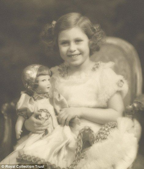 Princess Elizabeth (left) with her beloved Parisian doll and Margaret (right) in the late 1920s