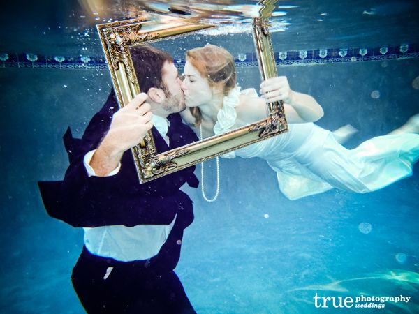 Bride and groom kissing at the bottom of the swimming pool, by True Weddings Photography