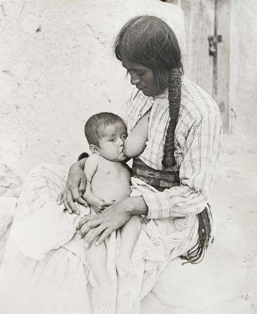 Hopi native american woman nursing baby