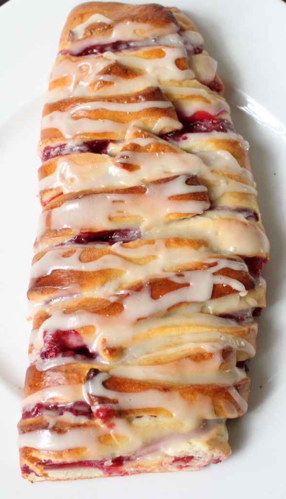 Raspberry Pastry Braid  THIS, my friends, is nothing short of amazing.  It is a bit time consuming, but the recipe makes FOUR (oh yea, FOUR) separate braids.  I made two with cherry pie filling, two with lemon.  Both were great, but cherry wins my vote.  Word of warning:  watch your heated milk temp, don't fry your little yeasties by getting it to hot! :)  YUMMO!  (this dough is amazing to work with as well!)