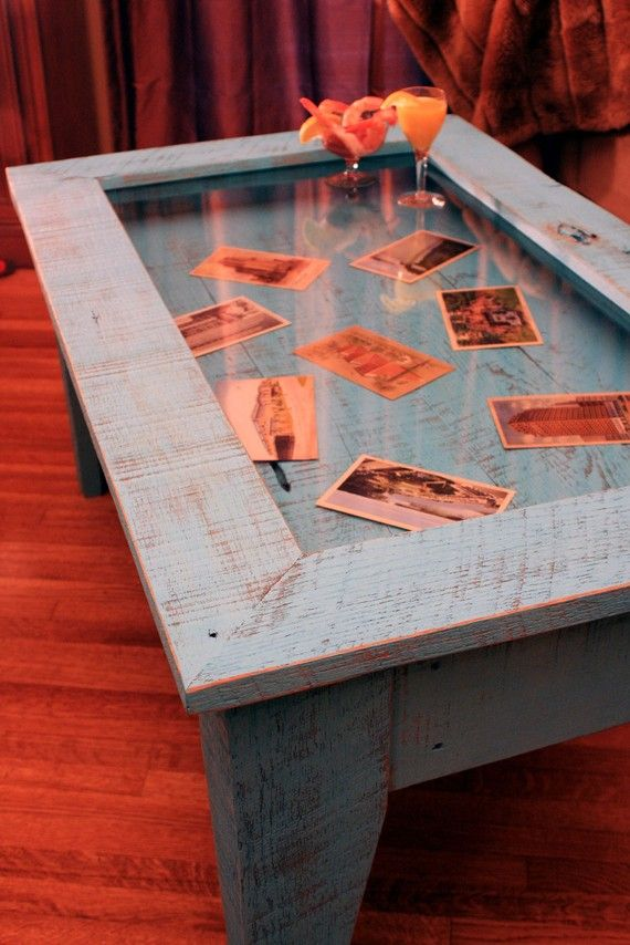 coffee table with hinged top. love this idea. it reminds me of the table at  my memaw& house with all the pictures under glass.